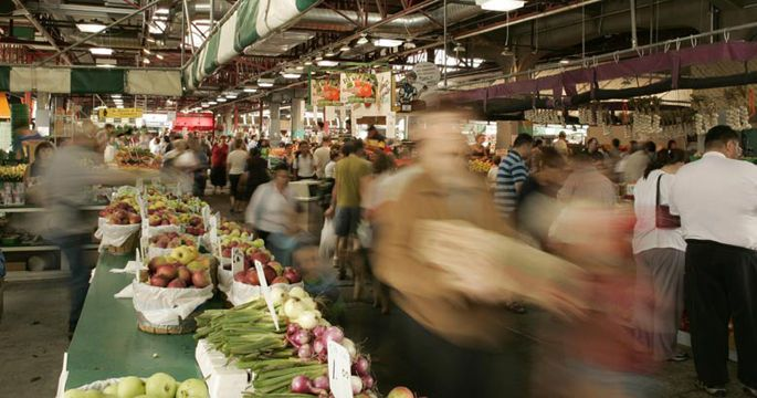 People grocery shopping in Montreal at the Jean-Talon Market