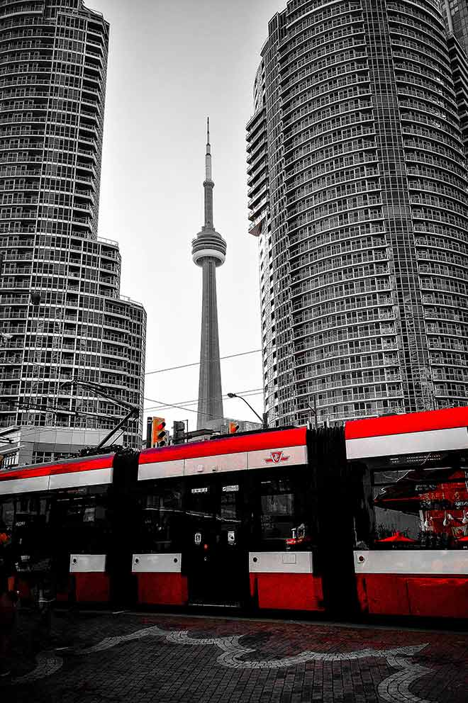 Toronto streetcar in front of CN Tower