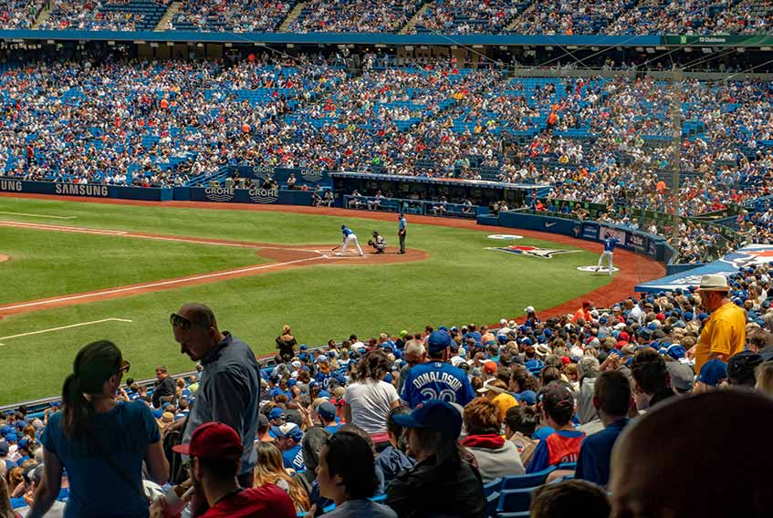 Crowded stadium at Blue Jays baseball game at Rogers Centre in Toronto