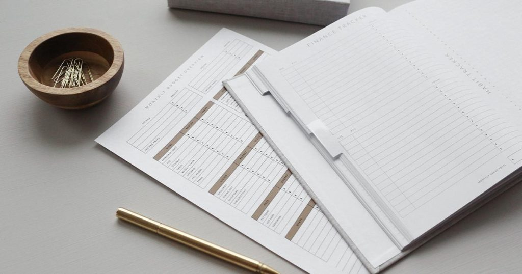 Desk full of financial planning documents